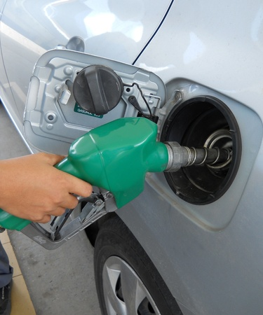 A man pumping gas in to the tank  photo