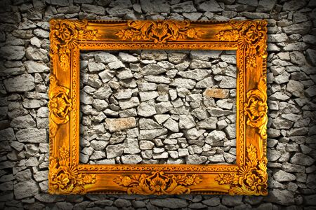 picture frame on wall of stones as a texture  photo