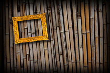 golden frame on  bamboo wall background Stock Photo - 11221861