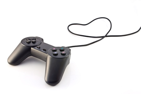 black game controller isolated on white background  photo