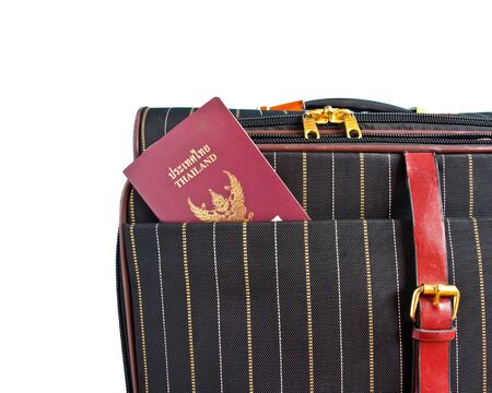 suitcase and thai passport isolated on a white background  photo