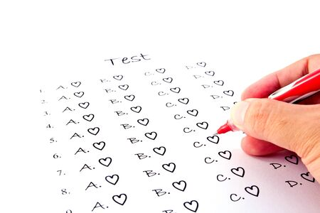 Hand on red pen choosing the test list on the examination  photo