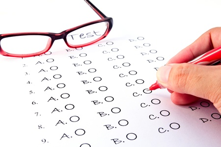 Hand on pen choosing the test list and glasses on the examination  Stock Photo - 11977124