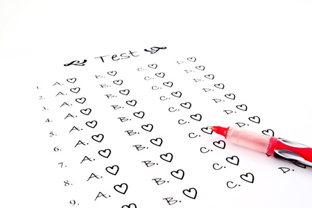 The test list and red pen on the examination  photo