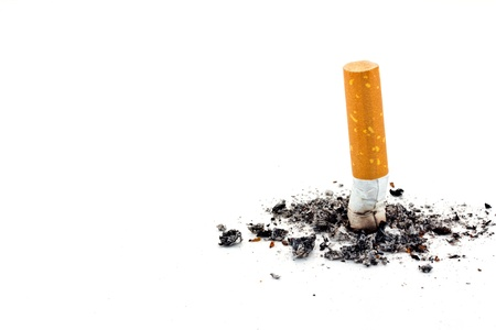 Single cigarette butt with ash isolated on white background  photo