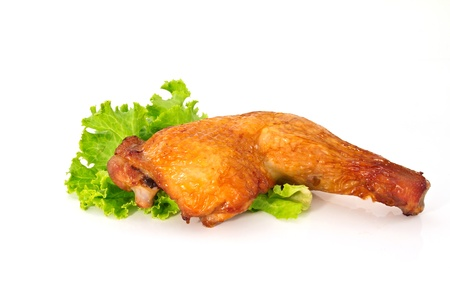 roasted chicken legs isolated on white background   photo
