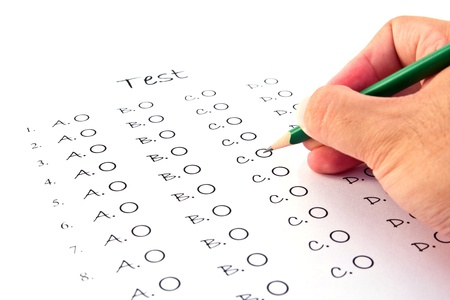 Hand on pencil choosing the test list on the examination