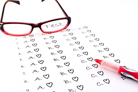 The test list and red pen and glasses  on the examination  photo