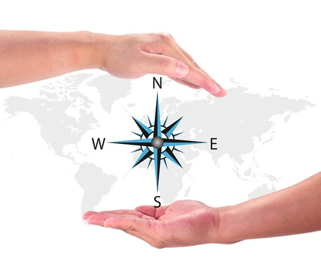 global logistics: Compass Rose on World Map in hand   Stock Photo