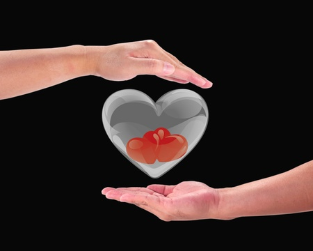Red heart on a mans hand.Heart on the palm - love symbol   photo