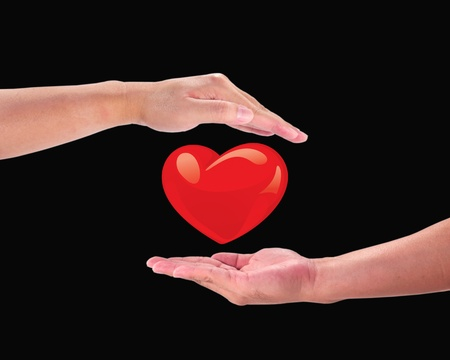 tender sentiment:  Red heart on a mans hand.Heart on the palm - love symbol   Stock Photo