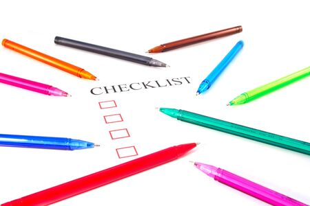 put tick: Checklist with pens and checked boxes