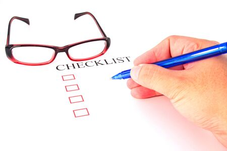 Checklist with pen, glasses and checked boxes Stock Photo - 13220309