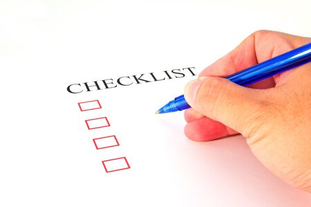 Checklist with pen and checked boxes   Stock Photo