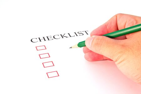 Checklist with pencil and checked boxes.  Stock Photo - 13220302