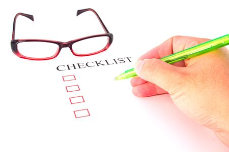 put tick: Checklist with pen, glasses and checked boxes.
