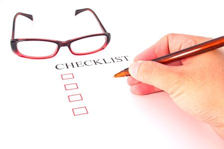 Checklist with pen, glasses and checked boxes Stock Photo - 13294326