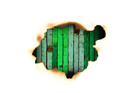 Burnt hole in a paper over green wooden Stock Photo - 13294328