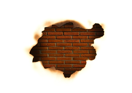 Burnt hole in a paper over  old brick wall  background  Stock Photo - 13409120