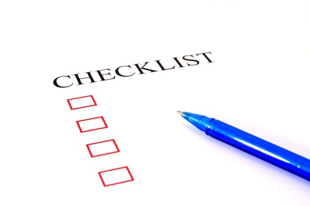 Checklist with pen and checked boxes. Stock Photo - 13409126