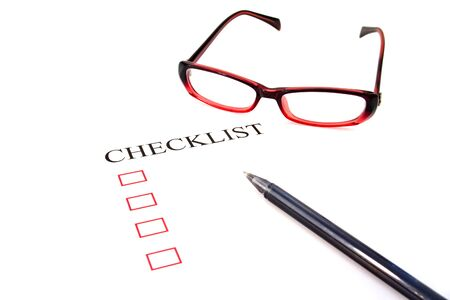 put tick: Checklist with pen, glasses and checked boxes