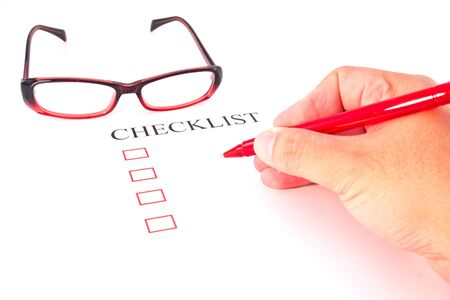 Checklist with pen, glasses and checked boxes   Stock Photo - 13564445