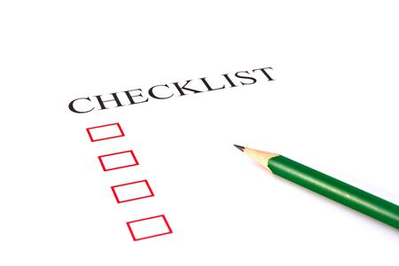 Checklist with pencil and checked boxes Stock Photo - 13564447