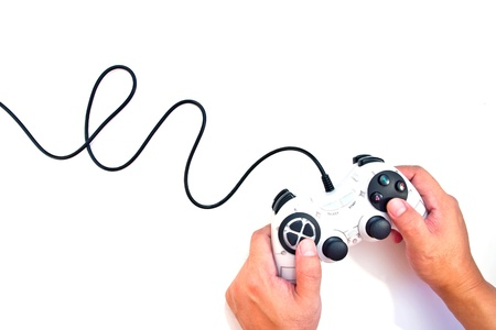 Hand on black game controller isolated on white background
