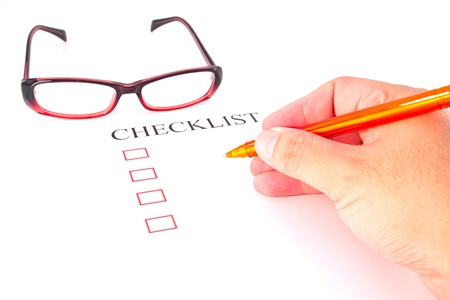 Checklist with pen, glasses and checked boxes.  Stock Photo - 13762885