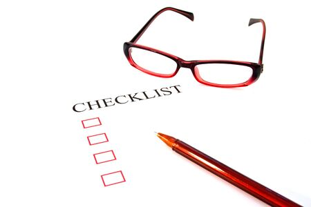 Checklist with pen, glasses and checked boxes.  Stock Photo - 13762882