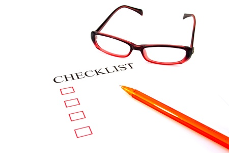 Checklist with pen, glasses and checked boxes Stock Photo - 14014783