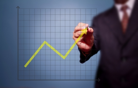 business man drawing over target achievement graph    Stock Photo