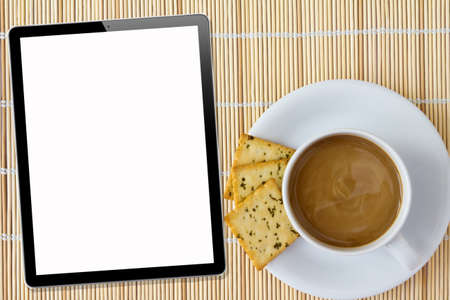 Coffee and Tablet. White porcelain cup and three biscuit on a mat photo