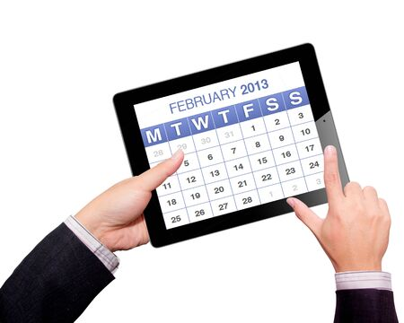 Hands with tablet computer calendar 2013. Isolated on white background.  photo