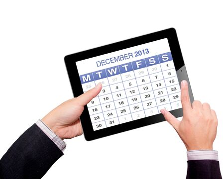 Hands with tablet computer calendar 2013  Isolated on white background   Stock Photo - 16332932