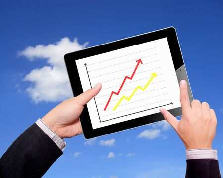 Business hands  graph on a tablet photo