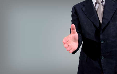 Cropped view of business man extending hand to shake photo