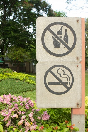 no smoking metal and no drinking alcohol sign in the park photo