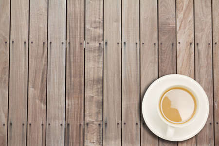 Coffee cup on wooden   photo
