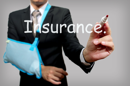 young businessman with broken hand wearing an arm brace, series Stock Photo - 23184818