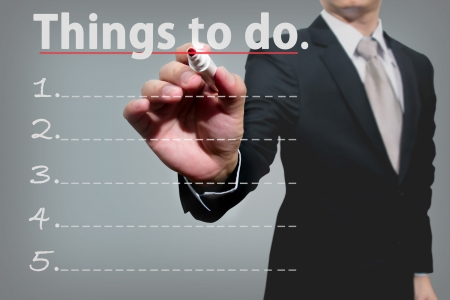 business man hand checking the things to do  Stock Photo
