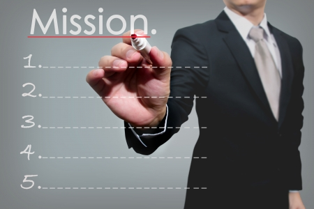 business man hand checking mission