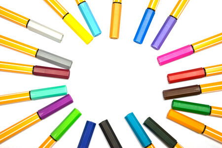 Colorful pens on isolated white background photo
