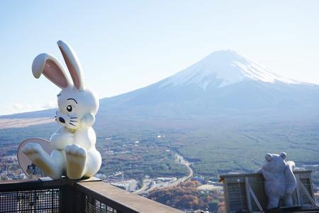 viewpoint: KAWAGUCHIKO - 28 NOV : An animal landmarks of mountain Fuji, White rabbit waiting on rooftop of viewpoint for mountain show from many cloud. On November 31, 2013 in Kawaguchiko, Japan