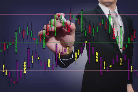 businessman drawing a stock  graph photo