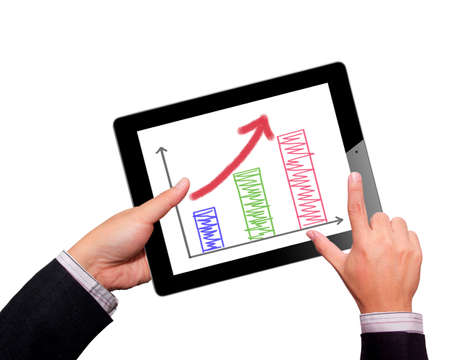 holding touch screen tablet and shows tablet in hand With graph Stock Photo