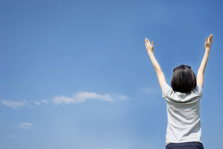 japanese people: female with arms out spread standing outdoors Stock Photo