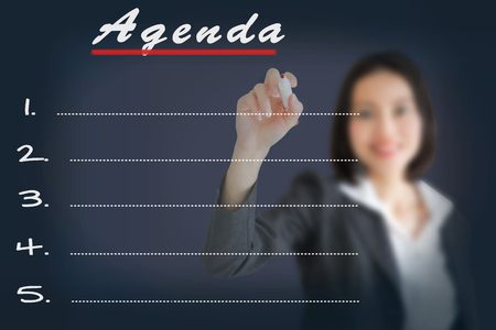 meeting agenda: Agenda Woman writing word