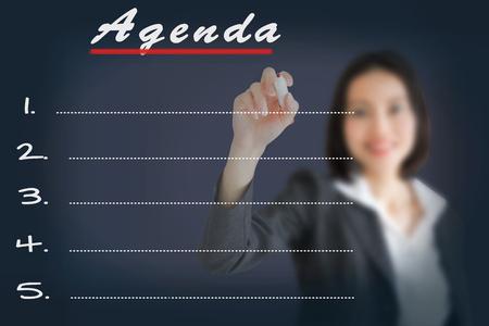 Agenda Woman writing word