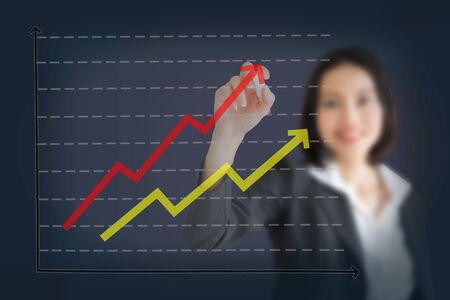 businesswoman suit: Business woman drawing graph showing profit growth on virtual screen. Asian businesswoman isolated on white background in suit.